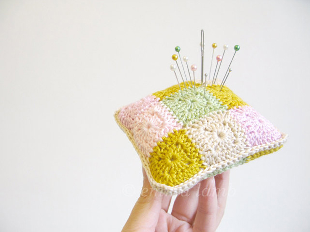 Crochet Pincushion hold by hand by Emma Lamb