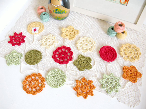 Colourful Crochet Flower Garland on the table by Emma Lamb