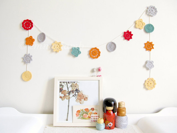 Crochet garland hanged on the wall by Emma Lamb
